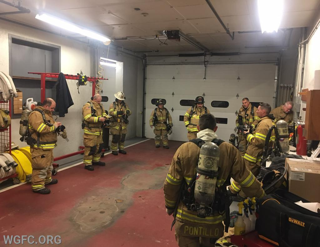 Members reviewing the basic donning and operations of the SCBA.