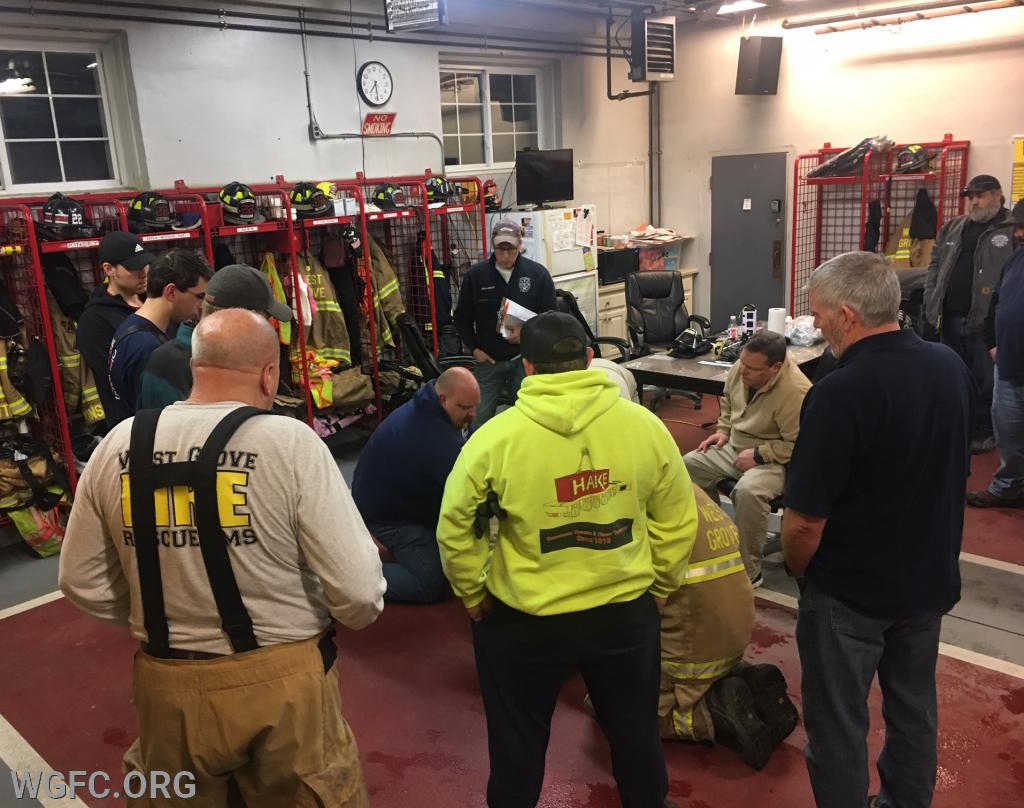 Members packaging a down firefighter.