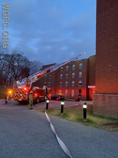 Ladder 21 positions at the front of the building