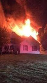 Fire through the roof as the first in crew prepares to enter this Franklin Township home during last night's incident
