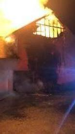 Just after arrival, the fire is through the roof on the east end of the home.