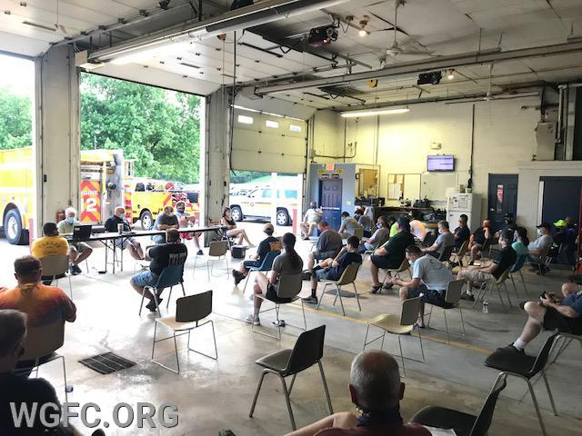 WGFC members hold the June business meeting at the New London Station, the first in-person meeting since the pandemic hit our area.