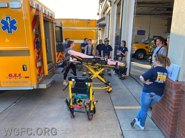 Membership Secretary Victoria Ford shows the group how to operate the powered stretchers carried on WGFC ambulances.