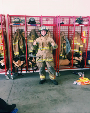 Ally Colgan poses in her turnout gear at the West Grove Fire Company.